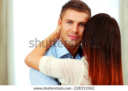 Portrait of a young couple hugging - stock photo