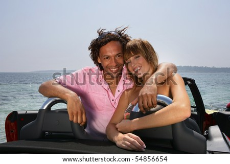 Portrait of a young couple in a car - stock photo
