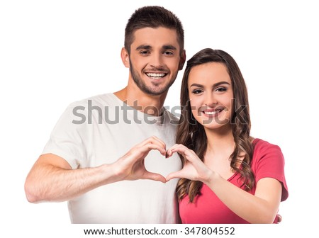 Portrait of a young couple in love isolated on white background