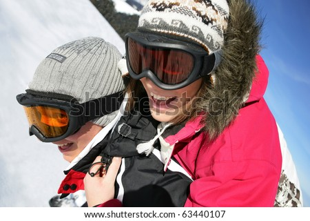 Portrait of a young couple in snow - stock photo