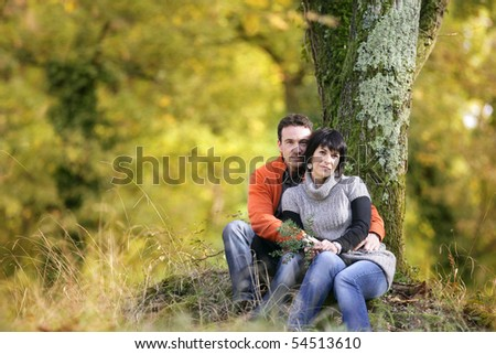 Portrait of a young couple in the countryside - stock photo