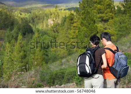 Portrait of a young couple of hikers - stock photo