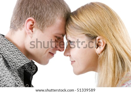 portrait of a young couple. They pressed their foreheads and smiling - stock photo