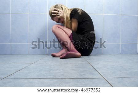 Portrait of a young crying girl - stock photo