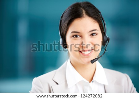 Portrait of a young customer support representative consulting the client - stock photo