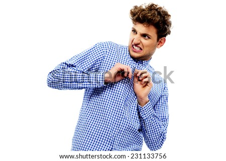 Portrait of a young disgusted man over white background - stock photo