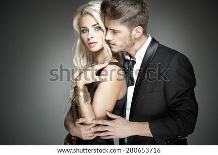 Portrait of a young elegant couple - stock photo