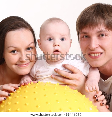 Portrait of a young family on a white background. The father, mum and the kid