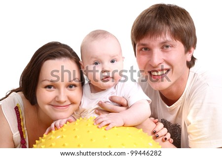 Portrait of a young family on a white background. The father, mum and the kid. A horizontal.