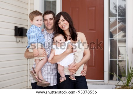 Portrait of a young family with mother, father, son and daugther - stock photo