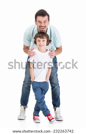 Portrait of a young father and his son on a white background.