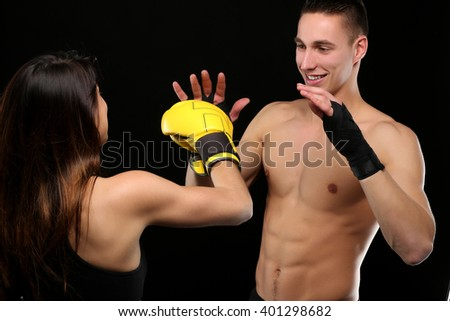 Portrait of a young female boxer and her coach training - stock photo