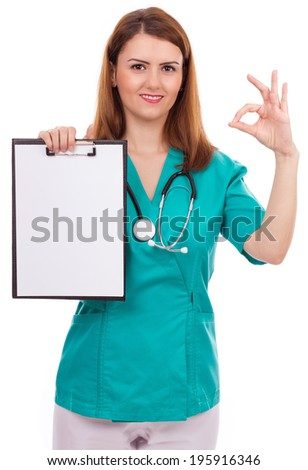 Portrait of a young female doctor holding a clipboard and showing ok sign isolated over white background - stock photo