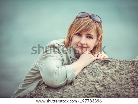 Portrait of a young female in beach - stock photo