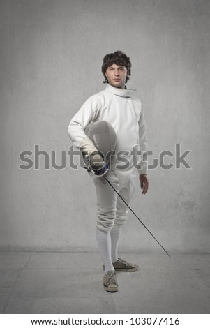 Portrait of a young fencer - stock photo