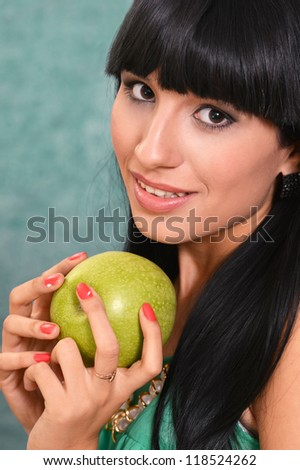 portrait of a young girl and green apple - stock photo