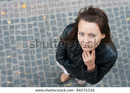 Portrait of a young girl, European, White, Caucasian, top view - stock photo