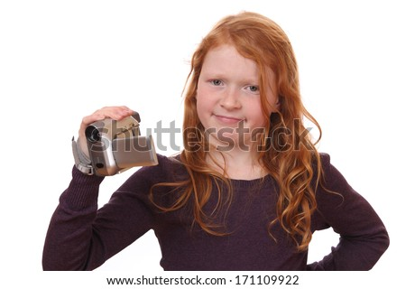 Portrait of a young girl holding a camcorder on white background - stock photo