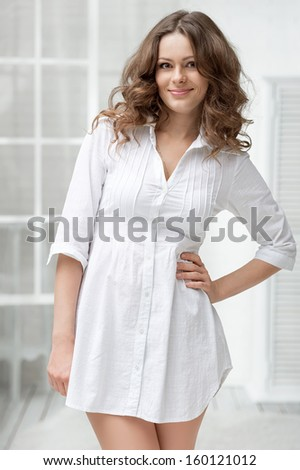 Portrait of a young girl in a bright interior - stock photo