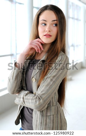 portrait of a young girl in a business office - stock photo