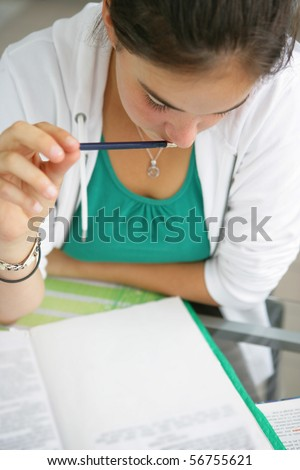 Portrait of a young girl in a classroom - stock photo