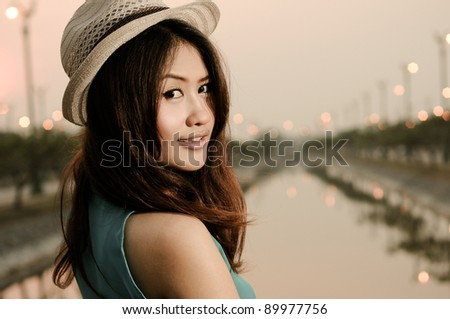 Portrait of a young girl in hat - stock photo
