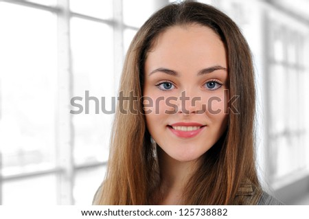 portrait of a young girl in office - stock photo