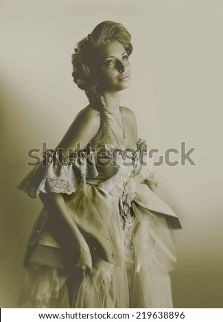 Portrait of a young girl in the style of old photos.makeup.fashion. - stock photo
