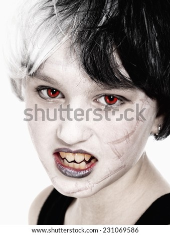 Portrait of a Young Girl in Wig Posing as Vampire