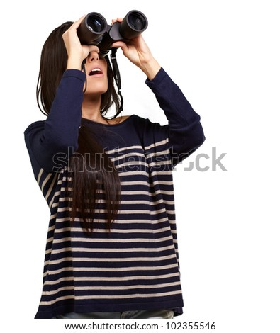 portrait of a young girl looking through binoculars over a white background
