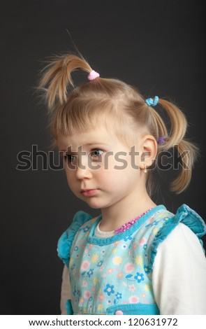 portrait of a young girl on a black background
