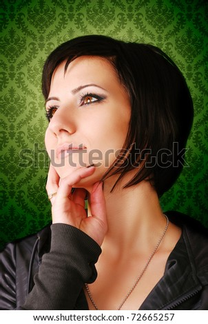 Portrait of a young girl on green background - stock photo