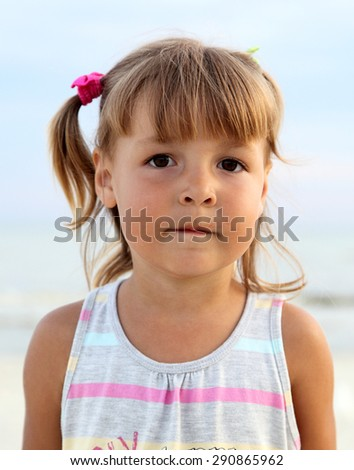 Portrait of a young girl on the background of the sea