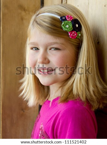 Portrait of a young girl or preteen, outdoors natural light