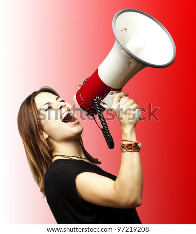 portrait of a young girl shouting with a megaphone over a red background