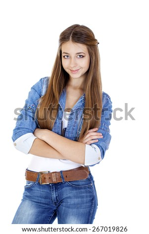 Portrait of a young girl teenager in jeans jacket and blue jeans, isolated on white background - stock photo