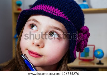 Portrait of a young girl thinking about school problem - stock photo