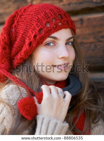 Portrait of a young girl wearing a red hat and sky glasses. - stock photo