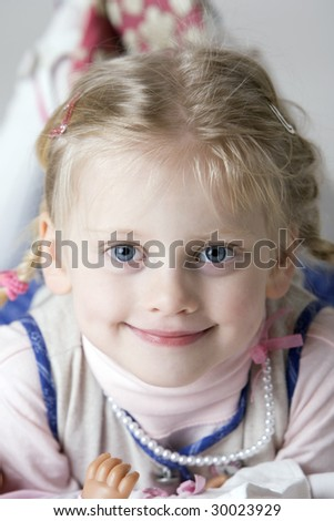 Portrait of a young girl which lying on the floor - stock photo