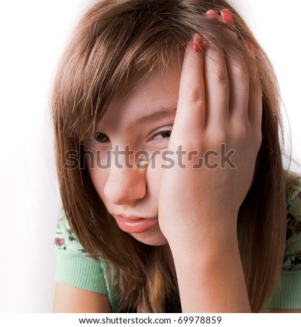 Portrait of a young girl with a bored expression - stock photo