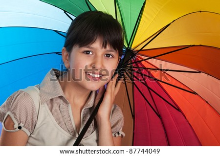 portrait of a young girl with a large color umbrella