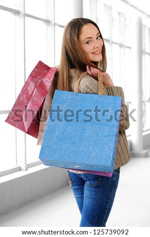 portrait of a young girl with bags for shopping - stock photo
