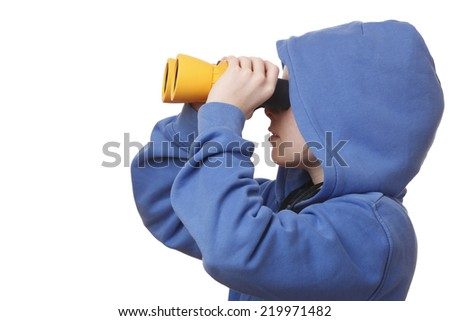Portrait of a young girl with binoculars on white background - stock photo