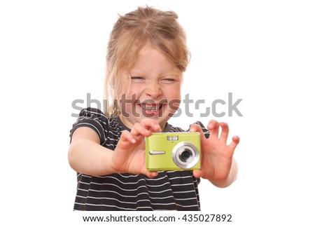 Portrait of a young girl with camera on white background - stock photo
