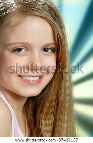 portrait of a young girl with long blond hair - stock photo