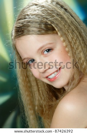 portrait of a young girl with long blond hair