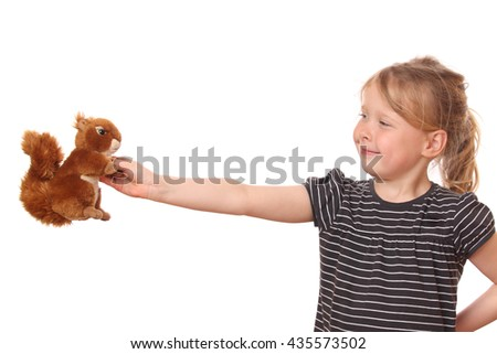 Portrait of a young girl with stuffed animal on white background - stock photo