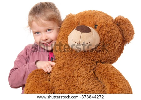 Portrait of a young girl with teddy bear on white background - stock photo