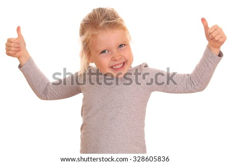 Portrait of a young girl with thumbs up on white background - stock photo