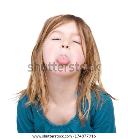 Portrait of a young girl with tongue out isolated on white background - stock photo